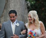 One of Shannon's closest friends, Dr. Tony Frogameni walking her down the aisle (Photo by Shannon Szyperski)