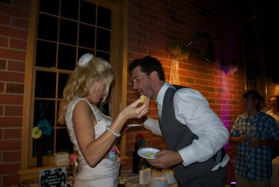 """It seems I """"accidentally"""" dropped a bite of cake down Shannon's dress. Don't worry, I got it."""