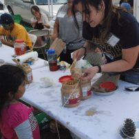 pine cone bird feeders were another craft at this event