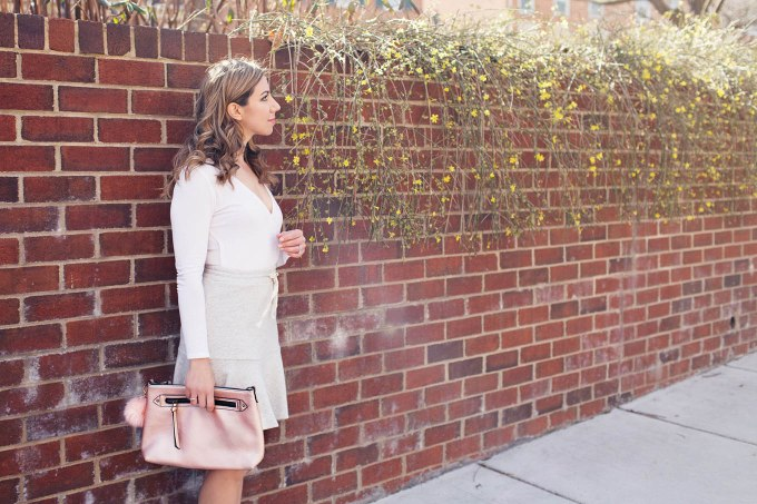 Lifestyle blogger Roxanne of Glass of Glam wearing an Anthropologie flounce skirt, asos bodysuit, M.Gemi flats, and a JustFab bag and talkinga bout ways to brighten your day