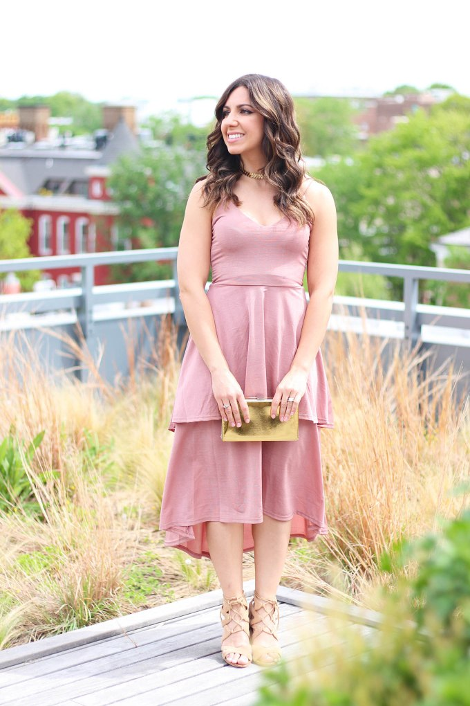 Lifestyle Blogger Roxanne of Glass of Glam wearing a blush Boohoo dress and gold box clutch