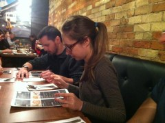 Vaughan and Anna diligently scoured the menus and ordered for the table.