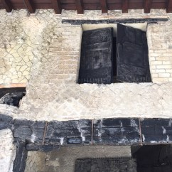 Carbonised shutters and door lintel. Ercolano, Italy