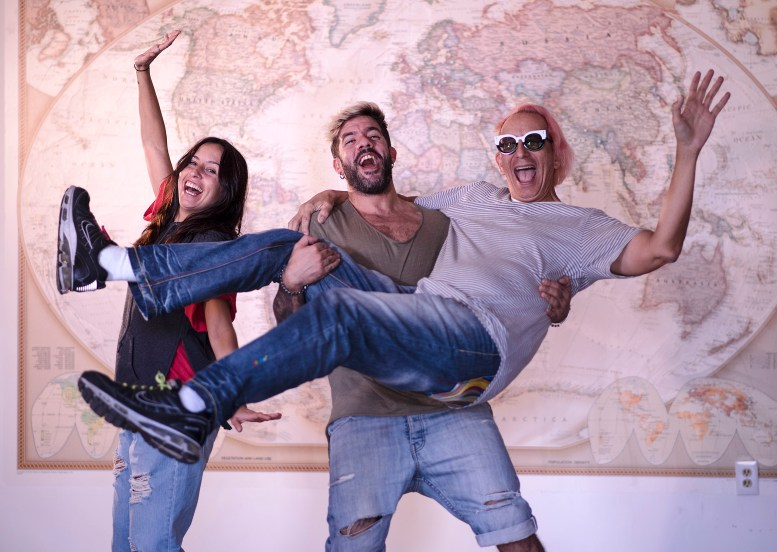 Pepa from Spain, Paulo from Portugal and Glenn from California in front of a large world map
