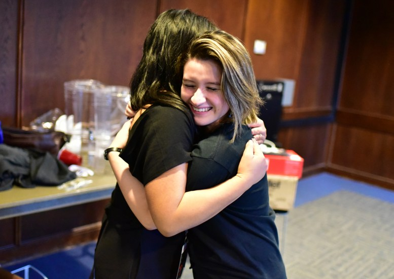 Curator Camille Raquel and Assistant-to-the-Curator Vania Arriola share a hug at the end of a long and successful TEDxCSULB 2017 event