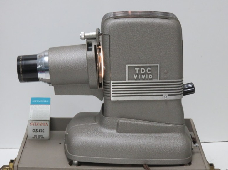 Photo of a TDC Vivid projector with a Sylvania CLS-CLG 300 watt lamp box next to it.