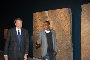 Photo of Jay-Z and Charlie Rose looking at the Assyrian Galleries at the Brooklyn Museum