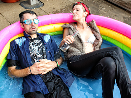 photo of Franco & Eva Mattes, clothed, in an inflatable swimming pool