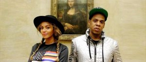 Beyonce and Jay Z in front of the Mona Lisa at the Louvre