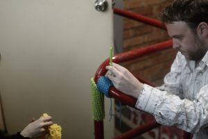 Creative Commons image of a yarn bomber in action from flickr