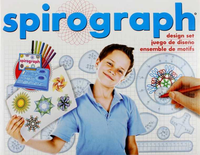 the box cover of a Spirograph toy showing a young boy holding some of his Spirograph drawings