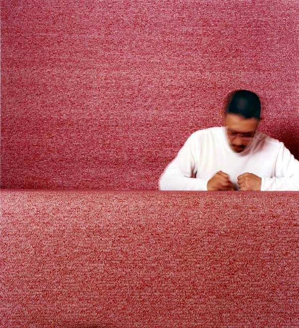 photo of Makoto Sasaki making many thousands of tiny red marks on huge sheets of paper