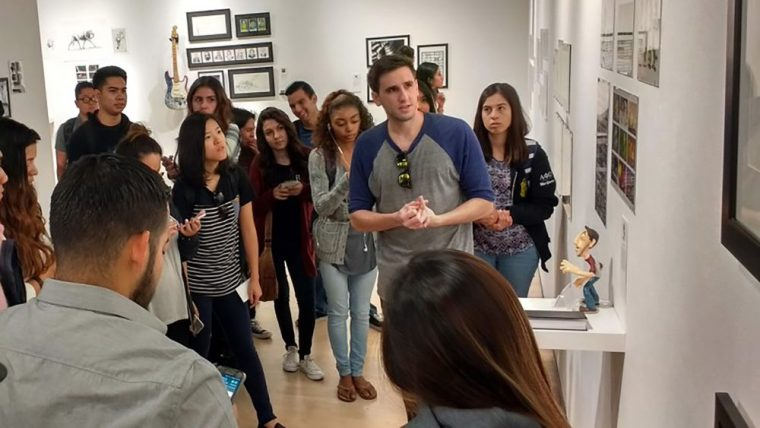 Tyler Turett discussing his work with Art110 students in the CSULB School of Art's Gatov Gallery