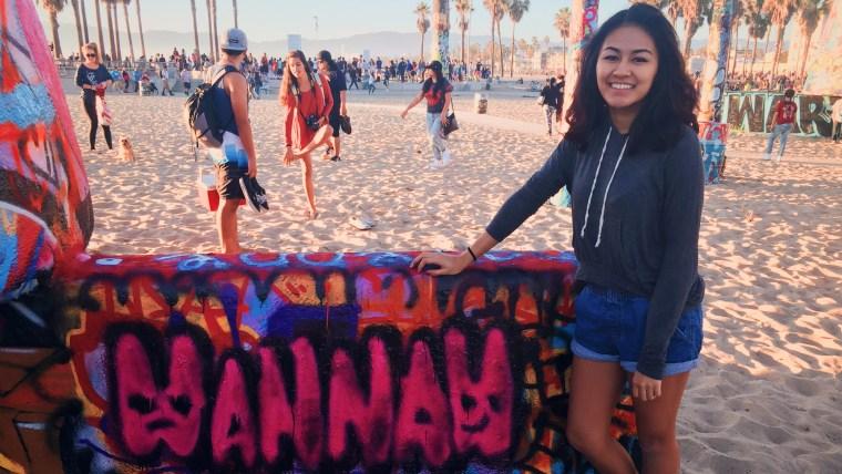 Hannah Mandias painting at the Venice Beach Art Walls