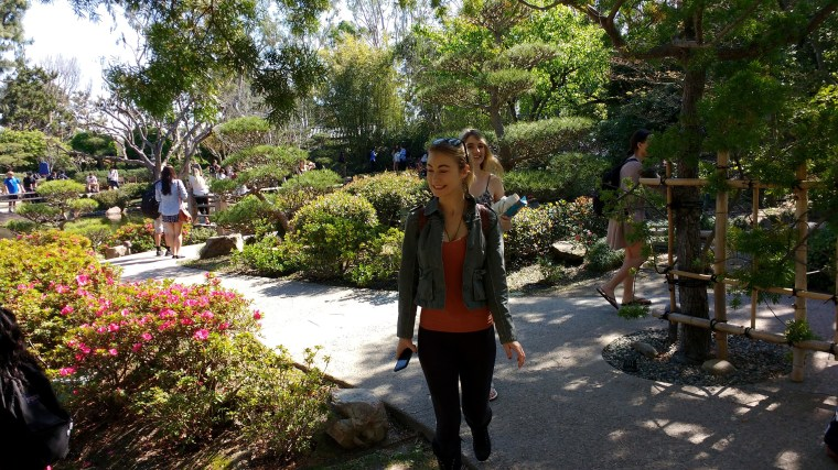 students meandering through the Earl Burns Miller Japanese Garden at CSULB