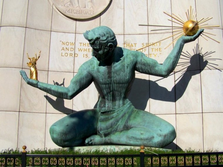 The Spirit of Detroit, a public artwork in Detroit, Michigan, showing a sitting man holding a sunburst in his hand