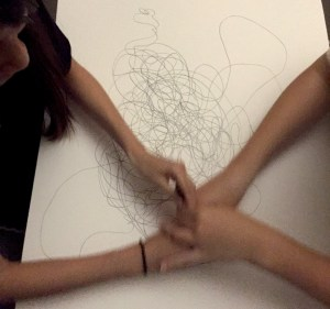 Lisa Bernhauser creating an automatic drawing with a friend