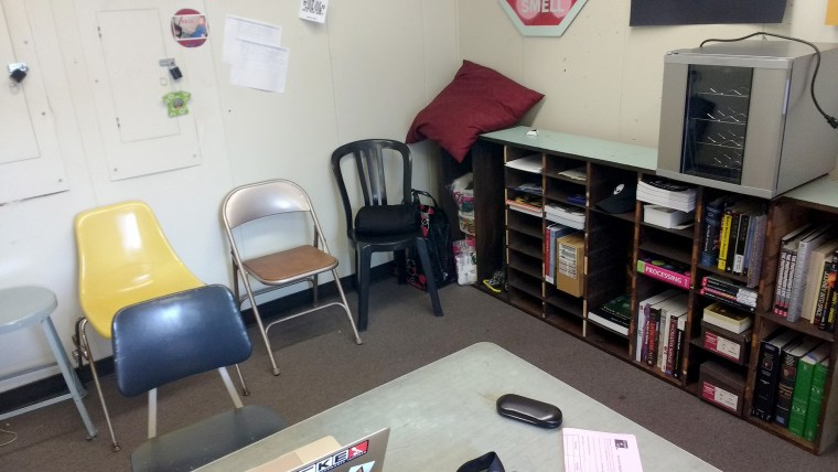 photo of inside of Faculty office FO4-267 at CSULB. Image includes desk, bookcase & chairs
