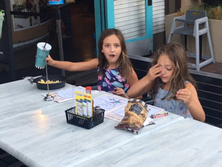 photo of 2 young girls eating lunch