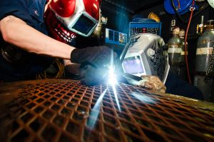 120108-N-GC412-001 ARABIAN SEA (Jan. 8, 2012) Hull Maintenance Technician 3rd Class Dustin Lenhardt and Hull Maintenance Technician 3rd Class Cody Eitniear weld in the sheet metal shop aboard the Nimitz-class aircraft carrier USS John C. Stennis (CVN 74). John C. Stennis is deployed to the U.S. 5th Fleet area of responsibility conducting maritime security operations and support missions as part of Operation Enduring Freedom. (U.S. Navy photo by Mass Communication Specialist 3rd Class Will Tyndall/Released)