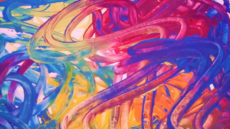 abstract finger painting in multiple colors