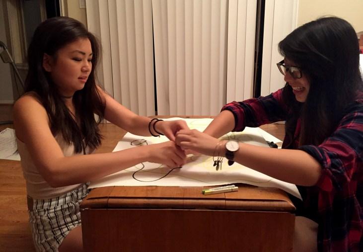 "Juli Yoshinaga making a pastel ""Automatic Drawing"" with a partner"