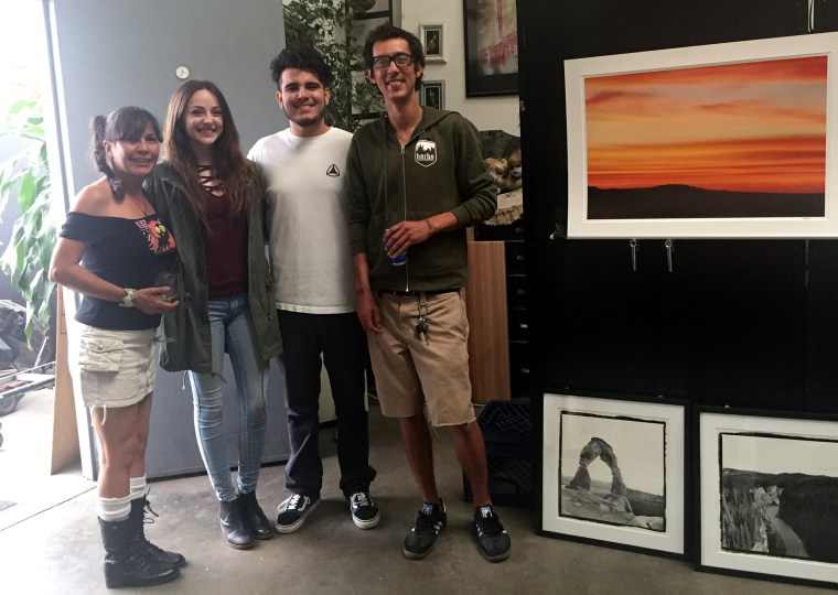 Jisel, Hannah, Nathan Davalos & Jim standing and smiling for the camera in one of the Artist's Live-Work spaces in The Brewery Artist's Colony in Downtown Los Angeles