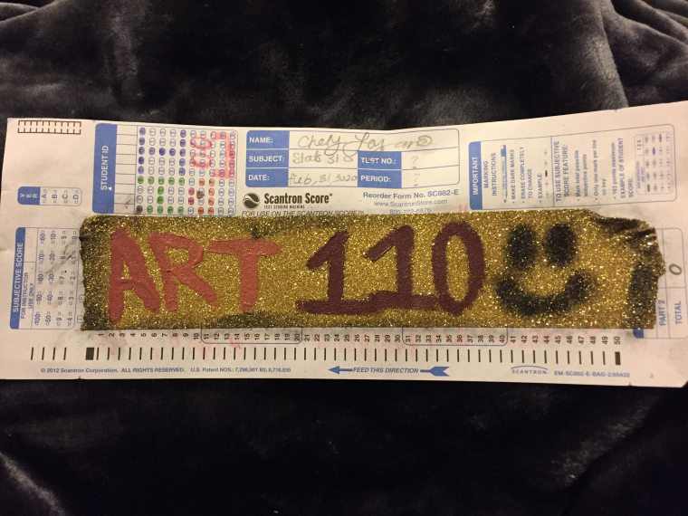 """a scantron test form painted with a big stripe and the text """"Art110"""""""