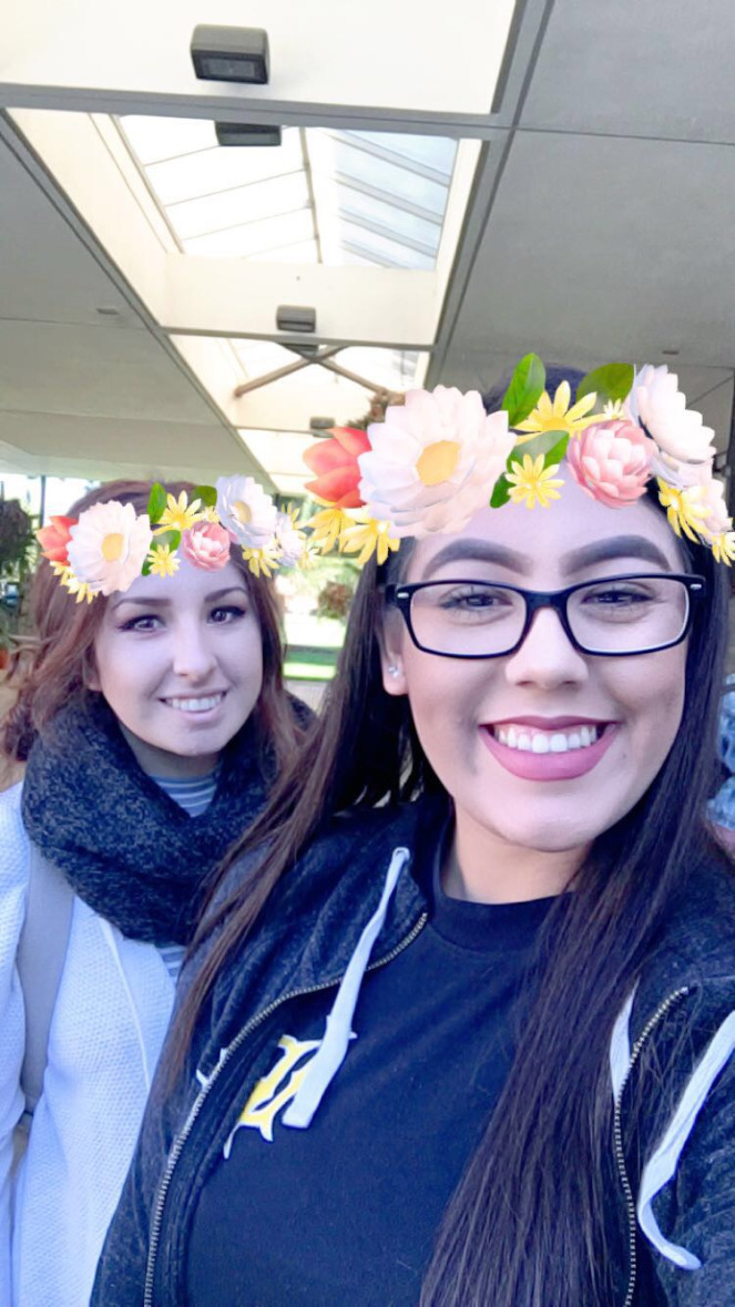 Snapchat photo of Aleah Lomeli & Yuliana wearing superimposed Snapchat floral wreaths