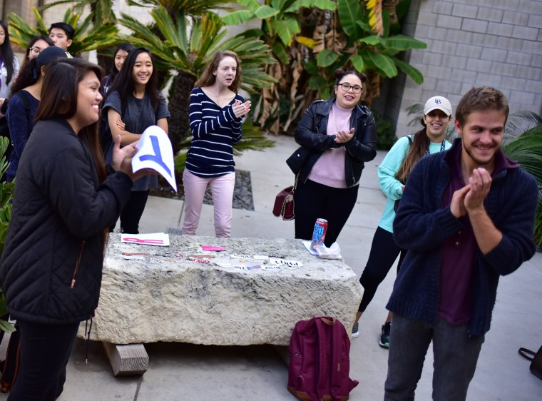 "CSU Long Beach, College of the Arts, School of Art, Art110: Introduction to the visual arts - course final: ""Art Games"" - students compete in a range of events including ""poetry writing"", ""art collecting"" and others in the School of Art, Art Gallery Courtyard"