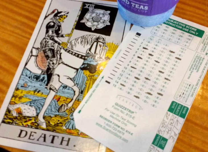 """Card XIII, """"Death"""" from the Rider-Waite-Smith Tarot deck, paired with a small Scantron form and a cup from Coffee Bean & Tea Leaf"""