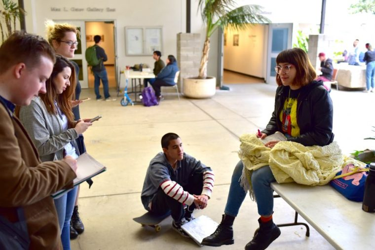 Vanessa Olivarez discussing her work with Art 110 students on a cold 22 March 2017