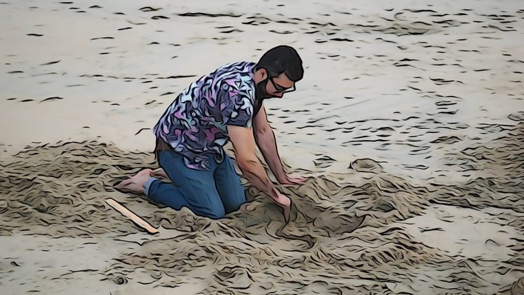 student working with sand at the Seal Beach Pier
