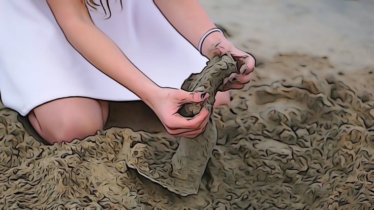 student cleaning a plaster casting at Seal Beach