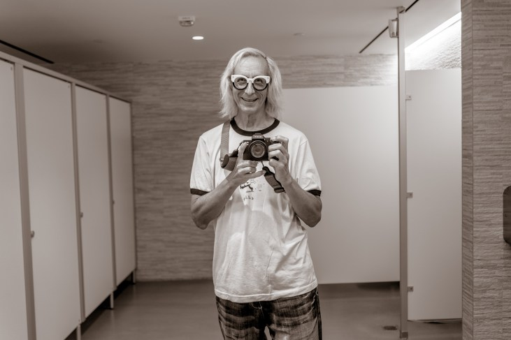 Glenn Zucman taking a selfie with a Sony a7iii camera in the mirror of the basement men's room at the Marciano Art Foundation on Wilshire Blvd in Los Angeles