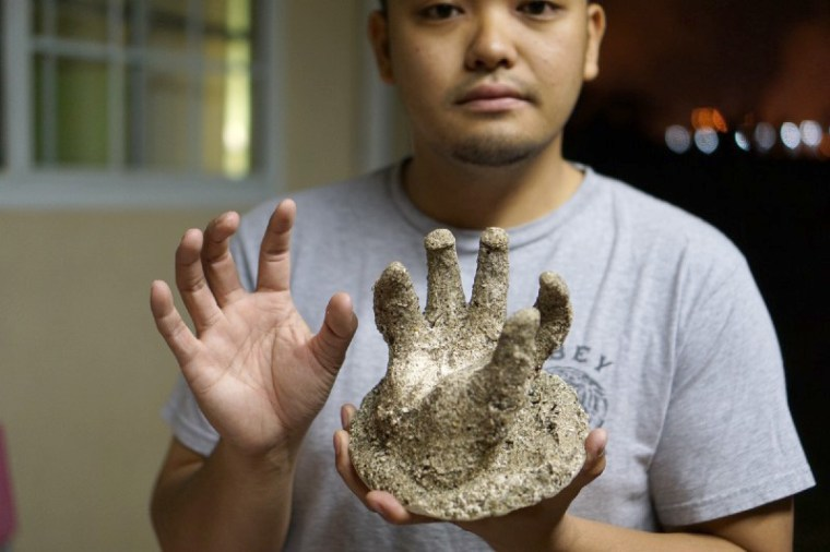 Alec with a plaster casting of his hand