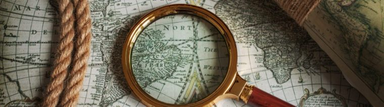 photo of a map with a magnifying glass on top of it