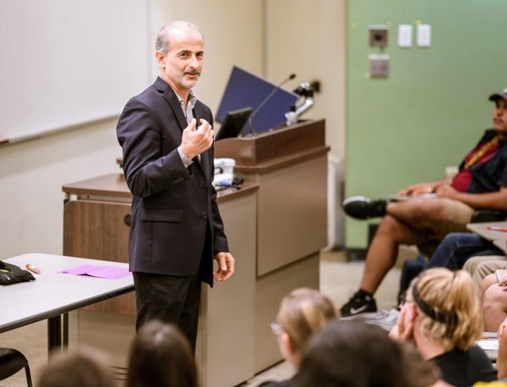 Dr. J speaking in room Psy-150