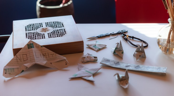 photo of scantron 882-e forms folded into various origami shapes including several origami cranes and other shapes