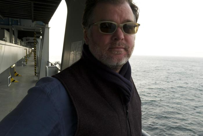 photo of Rob Long on the deck of a container ship at sea