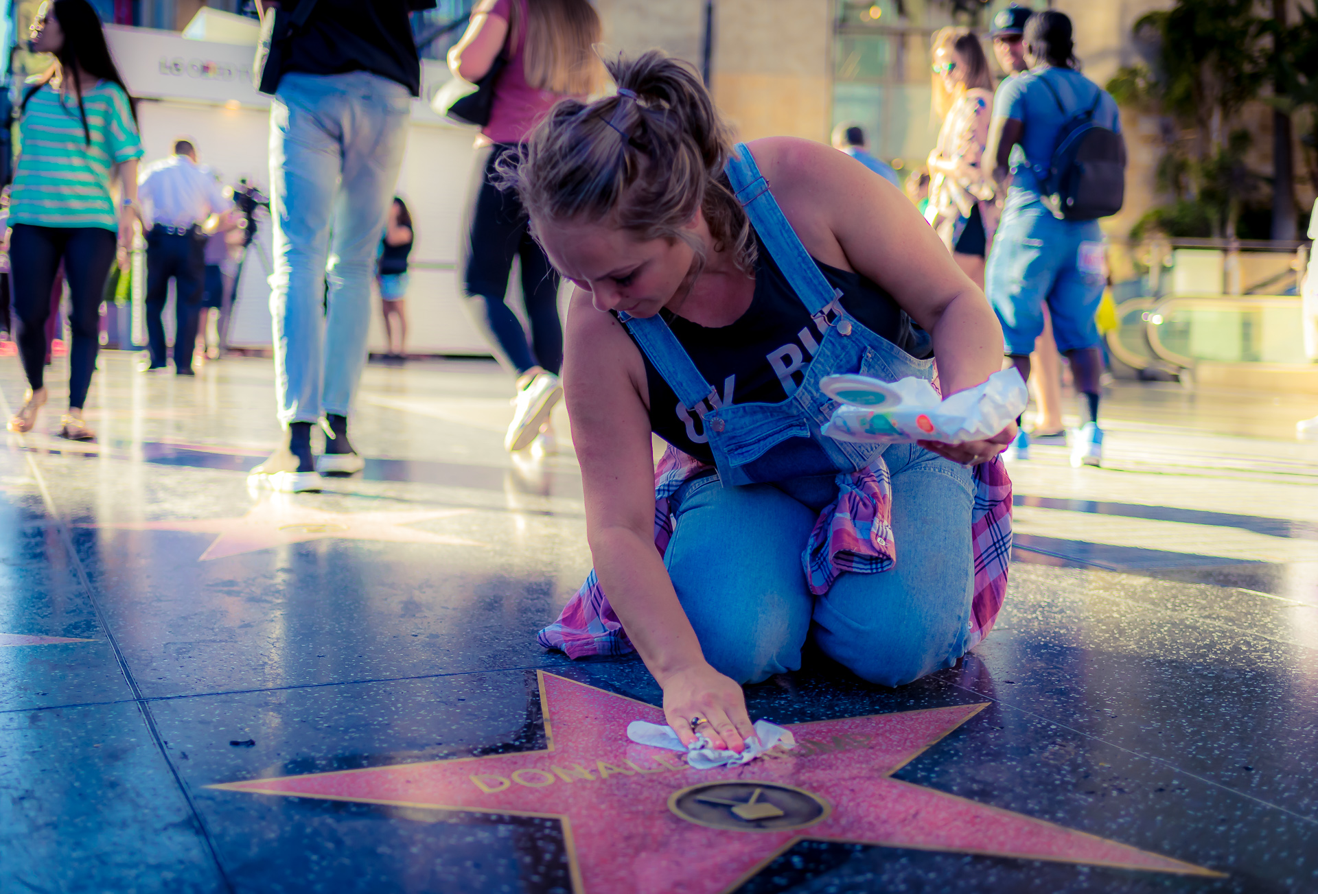 A woman cleaning the Donald Trump Star on Hollywood Blvd.
