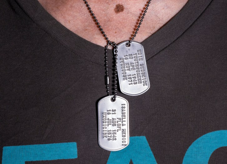 "photo of a pair of dog tags around a neck and over a v-neck t-shirt. 1st tag reads: ""Isabella Medici, FLOFL, 31 Aug 1542, 16 Jul 1576, uxoricide"". 2nd tag reads: ""Edie Sedgwick, Youthquaker, 20 Apr 1943, 16 Nov 1971, overdose""."