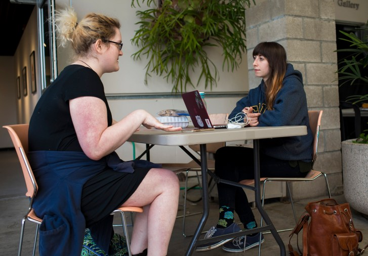 Jennifer Ostroff & May Roded sit across a table in conversation.