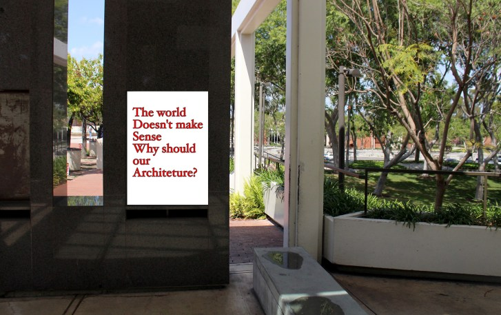 """The Wedge with a poster added. The poster reads, """"The world doesn't make sense, why should our architecture?"""""""