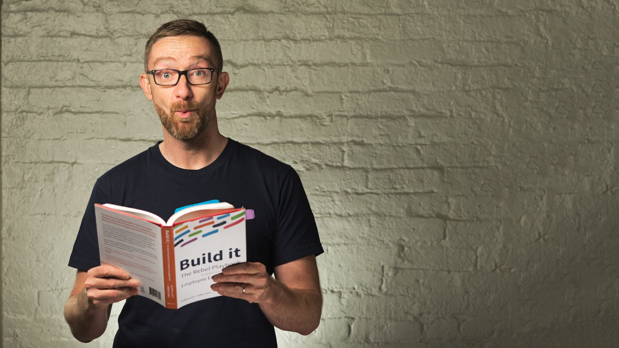 Author Glenn Elliott with Build it - The Rebel Playbook for Employee Engagement
