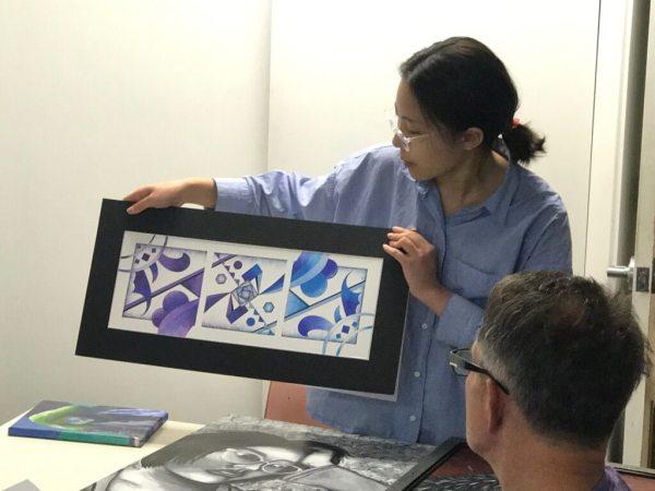 Artist presenting art.
