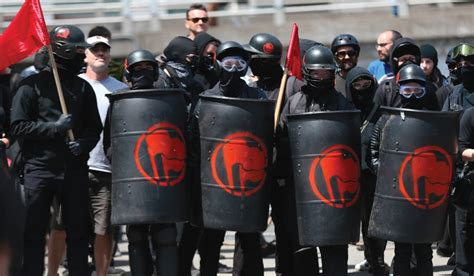 Pandemic Forces Antifa to Drop Masks and Don Pointy, White Hoods