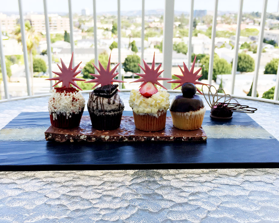This is a travel post by Glitter and Bubbles that features the Beverly Hilton in Beverly Hills, California.