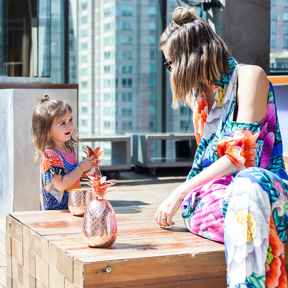 This is a mother daughter street style post by Glitter and Bubbles that features topknots and prints.