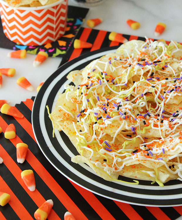 A chocolate covered chips recipe with sprinkles, melted chocolate and candy corn.